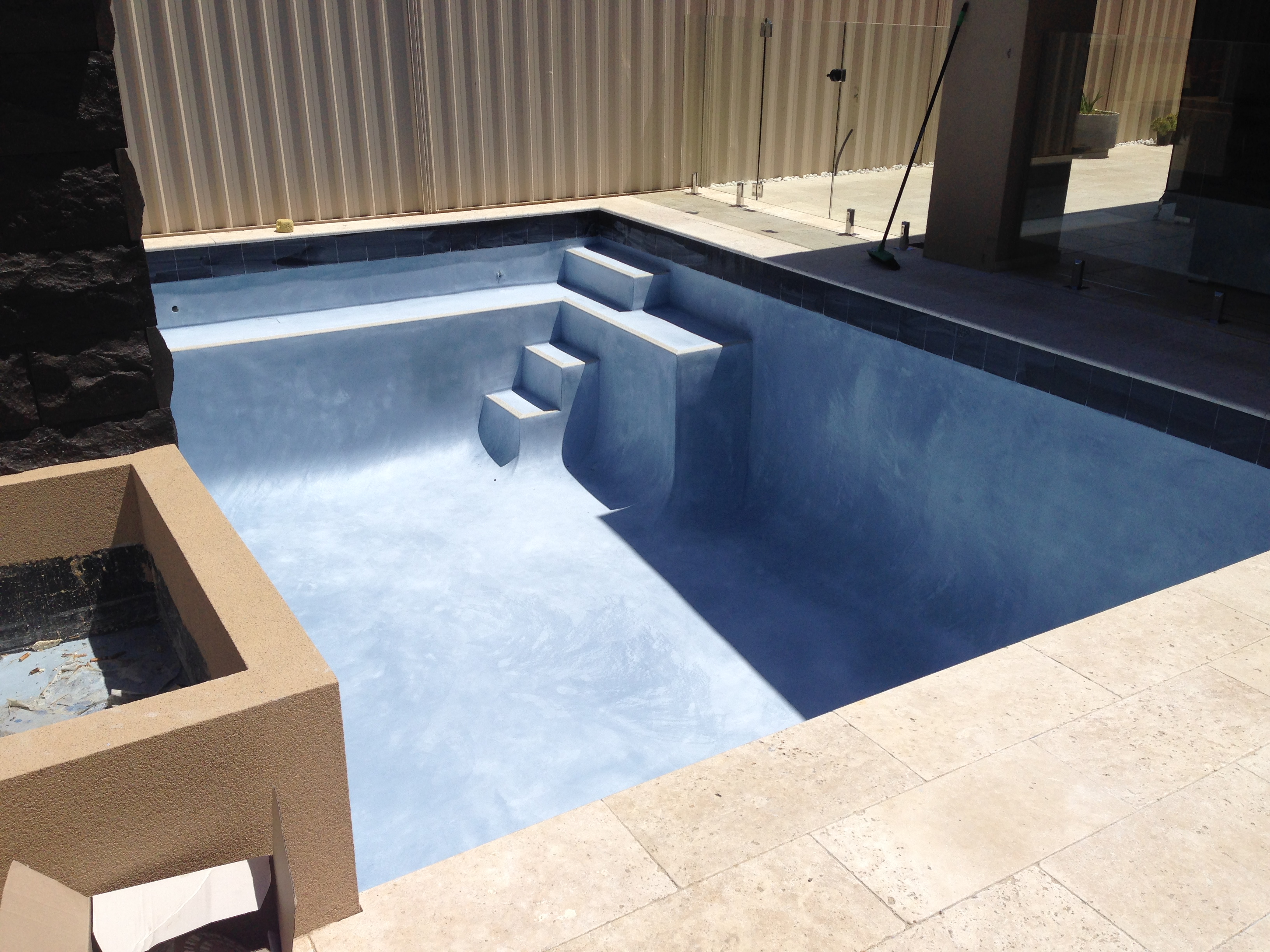 Concrete swimming pool interiors pools by design for Concrete swimming pool