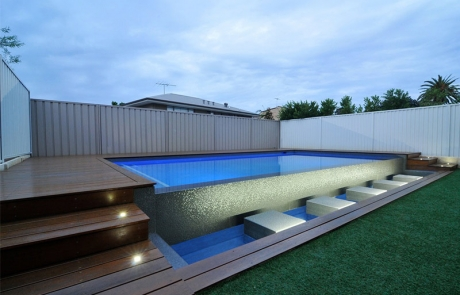 Bicton Concrete Geometric Pool with Spillover Edge and Stepping Stones