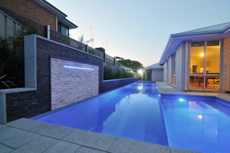 Melville Concrete Lap Pool with Feature Wall and Landscaping