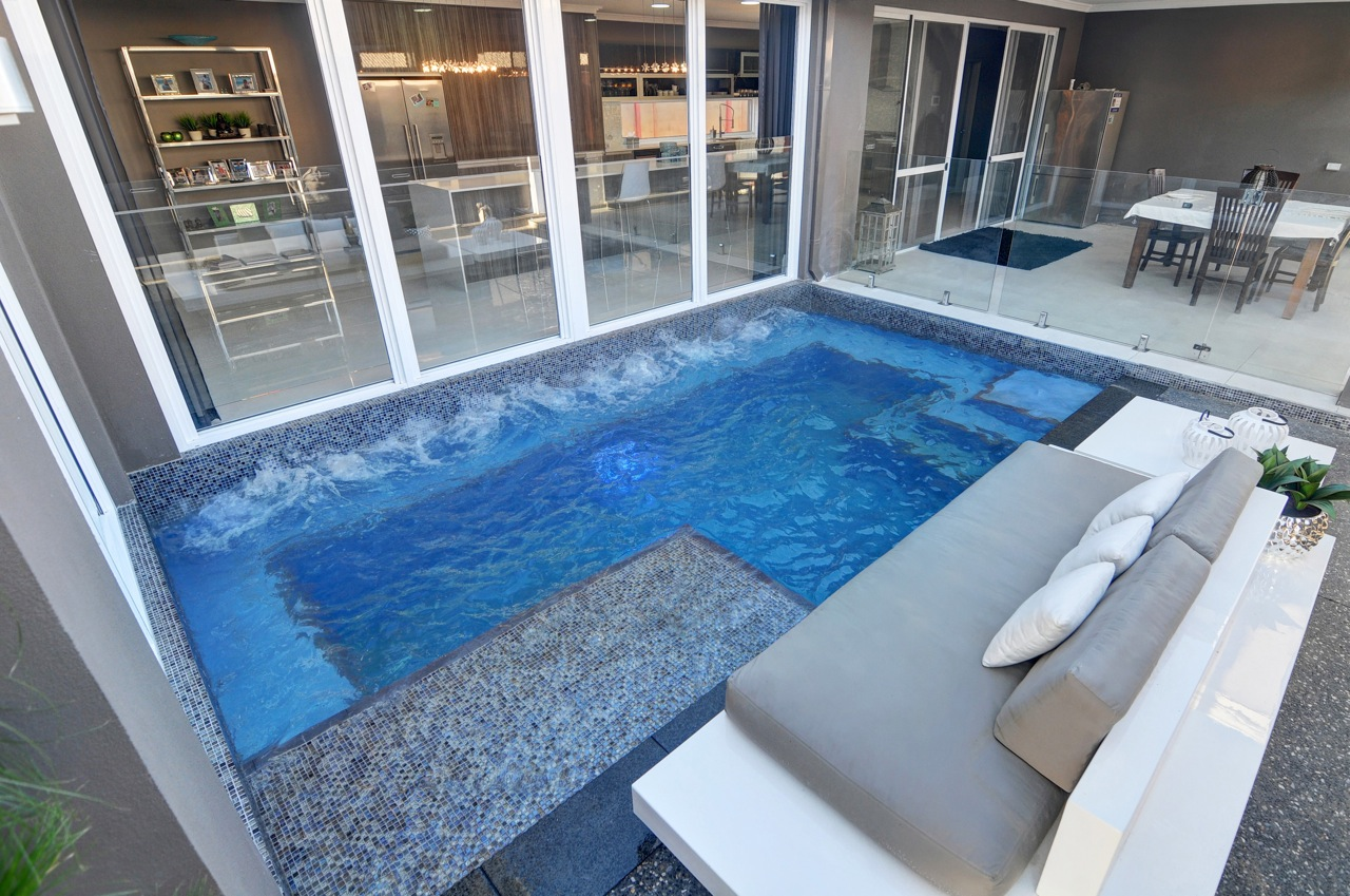 2014 gold winner residential courtyard plunge pool for Designer spas and pools