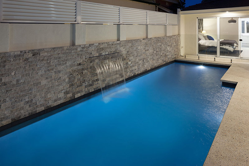 Claremont Concrete Geometric Pool with Cladded Wall and Water Feature