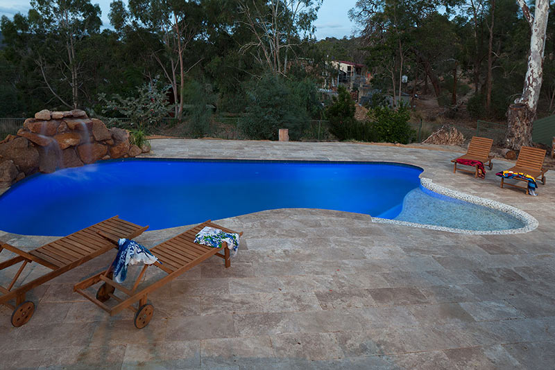 Swan view Concrete Freeform Pool with Pebbled Beach Entry