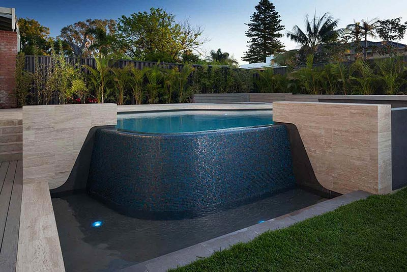 City Beach Concrete Goemetric Pool with Mosaic Infinity Edge